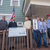 James Neiss/staff photographer <br /> Lockport, NY - Solar Liberty Consultants John Karyczak and Nate Verhague presented Lockport Cares with a donation. Accepting are, from left, Rev. Alan Bauch, president, and managers Dani Kelkenberg, Chris Yoder and Toby Mansfield.