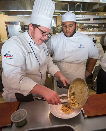 James Neiss/staff photographer <br /> Niagara Falls, NY - Chef John Pope works with Culinary Arts and Wine Beverage major Malik Kennedy as he prepares Pasta Carbonara for a guest at Savor. The Savor restaurant at the Niagara Falls Culinary Institute is changing over to an all-academic model featuring more students running the restaurant.