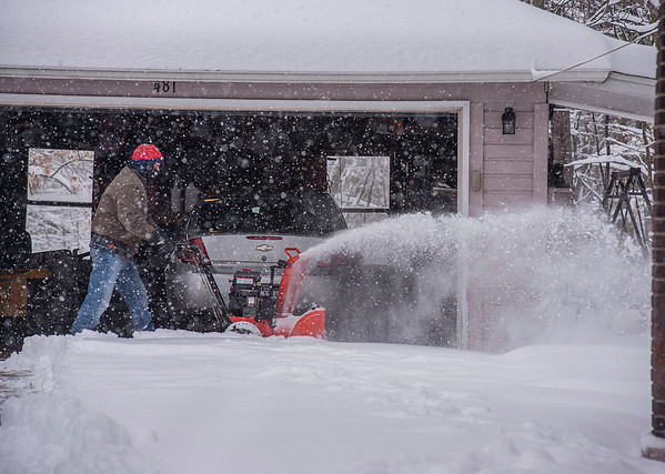 James Neiss/staff photographer <br /> Lockport, NY - Dan Ritz of Niagara Street clears the snow off his driveway from the first winter storm of the season.