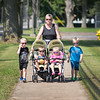 James Neiss/Staff Photographer<br /> Newfane, NY - You might have mistaken Robin MacFarland and her grandchildren for movie stars, sporting stylish sunglasses as they walked down East Avenue. In any case, the cousins from left, Owen Martin, 4, Jaxson Craft, 3, Adalynn Botting, 2 and Ashton Botting, 4, didn't seem to mind the paparazzo taking their photo.