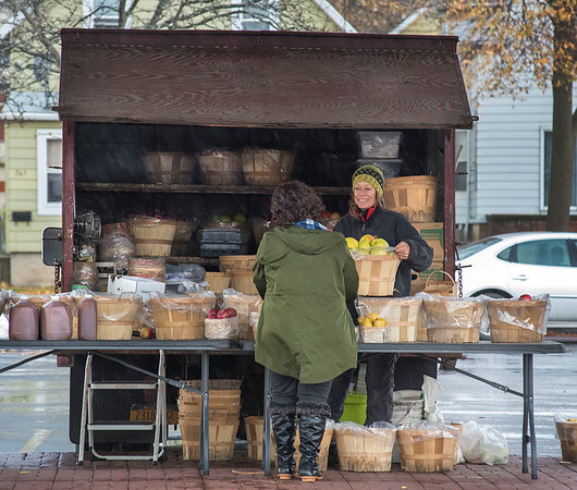 James Neiss/staff photographer <br /> Niagara Falls, NY - Sheri Senek of Senek Farms takes care of a customer at the City Market, that is switching over to their winter schedule open on Fridays from 9 a.m. to 2 p.m. through spring.