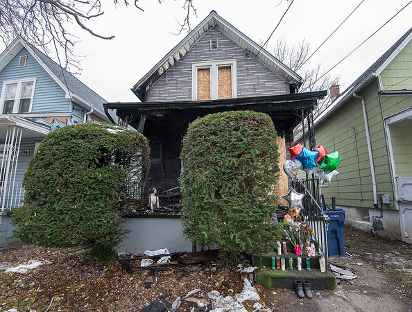 James Neiss/staff photographer <br /> Niagara Falls, NY - A memorial to the victim of a house fire on Ashland Avenue adorns the steps to the burned out house.