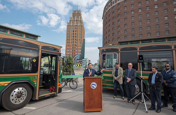 """James Neiss/staff photographer  Niagara Falls, NY - Niagara Falls Hotel Association President and hotel owner Frank Strangio, along with officials from the City of Niagara Falls and the Niagara Frontier Transportation Authority, announced the launch of NFTA Metro's 2019 Trolley Service on Green Your Commute Day.   Media Advisory Niagara Falls Metro Trolley Service makes it Easy to be Green Launch of Service Marks Green Your Commute Day  WHAT: The Niagara Frontier Transportation Authority, the City of Niagara Falls and the Niagara Falls Hotel Association, celebrates the launch of NFTA Metro's 2019 Trolley Service on Green Your Commute Day. This service supports the use of sustainable modes of transportation. The event will include a ribbon cutting ceremony and opportunities for attendees to take a Seasonal inaugural ride on one of Metro's """"green"""" trolley vehicles. Metro's trolleys will serve guests staying at participating hotels and motels along Niagara Falls Blvd., Pine Avenue, the Niagara Falls International Airport and within downtown Niagara Falls from May 17 through October 27, 9 a.m. to midnight.  WHO: Leaders from the Niagara Frontier Transportation Authority, City of Niagara Falls, New York State Legislature and the Niagara Falls Hotel Association.  WHEN: Friday, May 17, 2019 - 10 a.m. (Rain or Shine)  WHERE: Official Niagara Falls Visitor Center at 10 Rainbow Blvd. A reception catered by Antonio's Restaurant will be held immediately following the ceremony."""