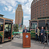 "James Neiss/staff photographer <br /> Niagara Falls, NY - Niagara Falls Hotel Association President and hotel owner Frank Strangio, along with officials from the City of Niagara Falls and the Niagara Frontier Transportation Authority, announced the launch of NFTA Metro's 2019 Trolley Service on Green Your Commute Day.<br /> <br /> <br /> Media Advisory<br /> Niagara Falls Metro Trolley Service makes it Easy to be Green<br /> Launch of Service Marks Green Your Commute Day<br /> <br /> WHAT: The Niagara Frontier Transportation Authority, the City of Niagara Falls and the Niagara Falls Hotel Association, celebrates the launch of NFTA Metro's 2019 Trolley Service on Green Your Commute Day. This service supports the use of sustainable modes of transportation. The event will include a ribbon cutting ceremony and opportunities for attendees to take a Seasonal inaugural ride on one of Metro's ""green"" trolley vehicles.<br /> Metro's trolleys will serve guests staying at participating hotels and motels along Niagara Falls Blvd., Pine Avenue, the Niagara Falls International Airport and within downtown Niagara Falls from May 17 through October 27, 9 a.m. to midnight.<br /> <br /> WHO: Leaders from the Niagara Frontier Transportation Authority, City of Niagara Falls, New York State Legislature and the Niagara Falls Hotel Association.<br /> <br /> WHEN: Friday, May 17, 2019 - 10 a.m. (Rain or Shine)<br /> <br /> WHERE: Official Niagara Falls Visitor Center at 10 Rainbow Blvd. A reception catered by<br /> Antonio's Restaurant will be held immediately following the ceremony."