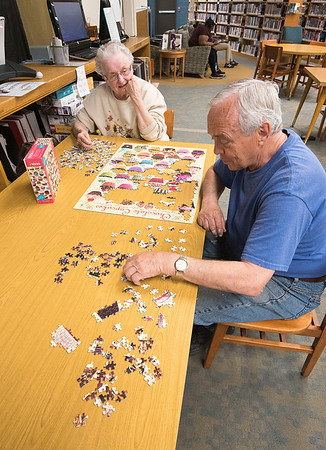 "James Neiss/staff photographer <br /> Medina, NY - Irene Kozody and Fred Cavers of Medina said they just like to spend time together working on puzzles at the Lee-Whedon Memorial Library. ""We have no schedule, Kozody said. We get together when the mood moves us or I find a special puzzle to work on."""