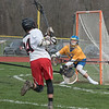James Neiss/staff photographer <br /> Sanborn, NY - Niagara-Wheatfield Lacrosse player #14 C. Chapman scores against Lockport goalie #33 Oliver Hammond during 1st period game action.