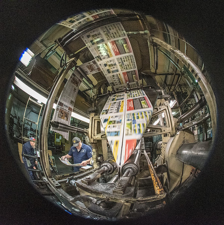 James Neiss/Staff Photographer<br /> North Tonawanda, NY - Pressmen Mike Klemm looks at the print quality as the presses ramp up to full speed. (Fisheye Lens shot)