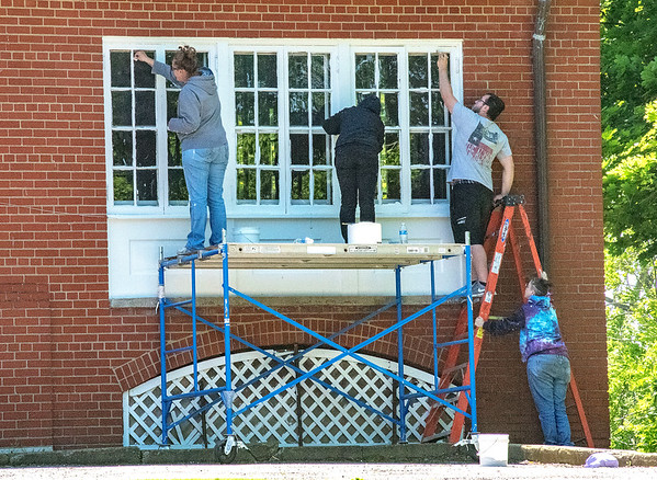 James Neiss/staff photographer <br /> Youngstown, NY - Volunteers from Stellar Technology in Amherst help to spruce up the historic Officers Club at Fort Niagara State Park on Friday. The group, from left, Joleen Sommerds, Inessa Gugamyants, Jason Stopka and Stacey Andrews, said the company gives each employee 8 hours of paid volunteer time, and this is the 4th year the volunteers chose Fort Niagara State Park as the recipient of their time and efforts.