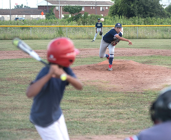 James Neiss/Staff Photographer<br /> Niagara Falls, NY - Yankees pitcher #23 Derek McIntyre lobs one in during the 4th Inning.