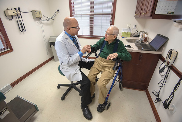 James Neiss/staff photographer <br /> Lockport, NY - Doctor Brijendra K. Gupta's genuine warm greeting for 95 year old Don Fogle, a patient for over 30 years, exemplifies a bedside manor mastered over the course of all those years. Gupta plans to retire from his practice at the end of May.