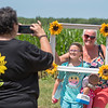 James Neiss/Staff Photographer<br /> Cambria, NY - Flower Manager Pam Graff snaps a photo of Hannah Piotrowski and her mother Tammy at Sunflowers of Sanborn. Mother and daughter traveled from Kenmore to visit Sunflowers of Sanborn at 3311 Saunders Settlement Road, on opening day.