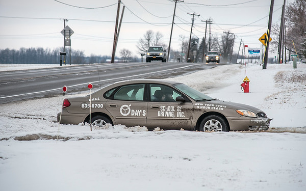 James Neiss/staff photographer <br /> Cambria, NY - Waiting for a Tow: This scene along Saunders Settlement Road in the town of Cambria is testament that winter in Western New York is a hard test for the experienced, let along novice drivers.