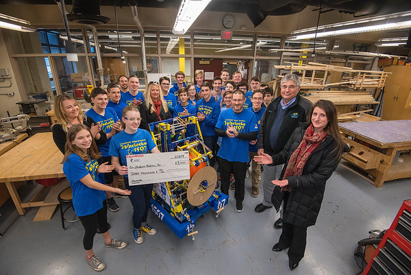 James Neiss/staff photographer <br /> Lockport, NY - Representatives from ExxonMobile and Reid Petroleum partnered up with the Lockport High School technology program Lockport Robotics Inc. giving them a check for $3000 to help take the program into 2020.