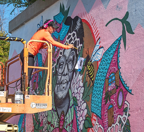 """James Neiss/staff photographer <br /> Niagara Falls, NY - Artist Ashley Kay works on a mural of Niagara Falls native Doris Jones, part of the Niagara Falls National Heritage Area facelift on Main Street across from the train station. Funding comes from the New York State Health Foundation, as part of the """"The Walk to Freedom: A Heritage Walking Trail for Niagara Falls"""" grant."""
