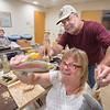 James Neiss/Staff Photographer<br /> Lewiston, NY - Kathy Zasucha of Porter and Bob Gnann of Lewiston show off their carving skills during a meeting of the Lewiston Senior Center Wood Carvers. The group meets every Thursday at 9 a.m. and encourages those who have and interest in carving to come join them on Thursday mornings.