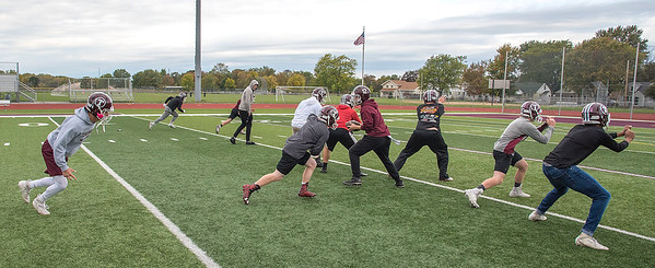 James Neiss/staff photographer <br /> North Tonawanda, NY - The Tonawanda High School football team run a play during practice.