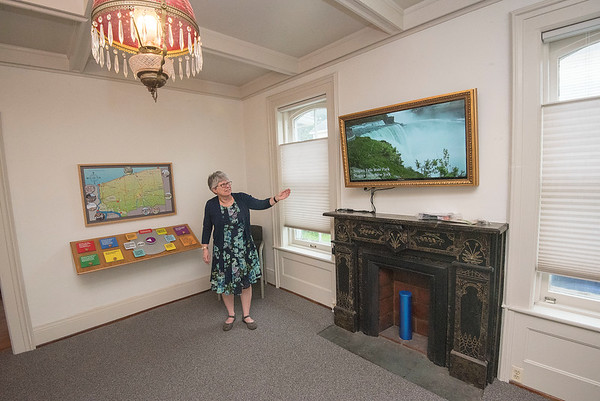 James Neiss/staff photographer <br /> Lockport, NY - Melissa Dunlap, executive director of the Niagara County Historic Center, shows off some of the features in the new Orientation Room including an interactive display and video production featuring the historic places in Niagara County. Dunlap said more improvements are in the works.