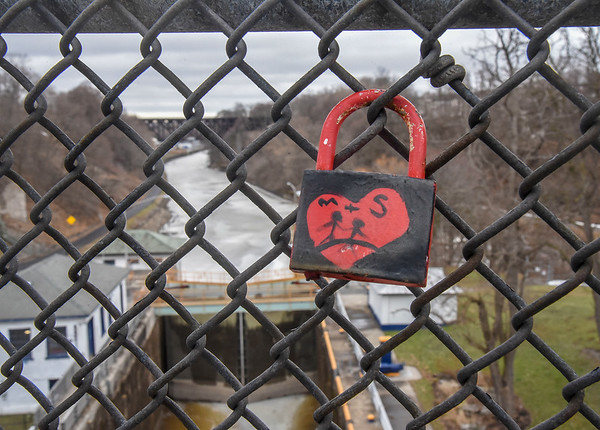 James Neiss/staff photographer <br /> Lockport, NY - As an expression of love, people are putting locks on the bridges over the Erie Canal in Lockport, similar to a movement in France.