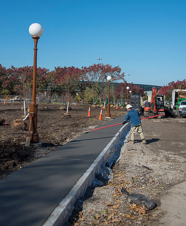 James Neiss/staff photographer <br /> Niagara Falls, NY - Ryan Smith with cement masons local 111 puts the finishing touches on a sidewalk near the main park entrance.