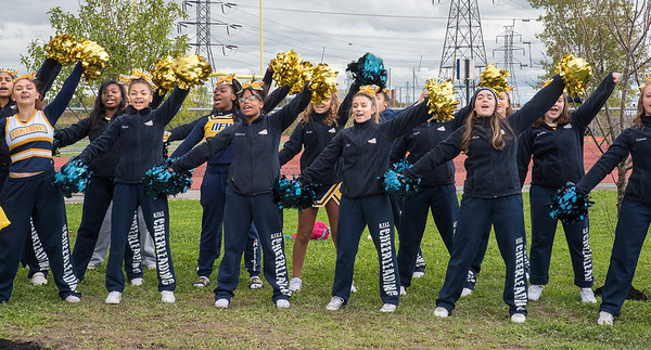 James Neiss/staff photographer <br /> Niagara Falls, NY - The Niagara Falls High School cheerleaders do a cheer for the Calandrelli family and guests. Ellen Latham, founder of Orange theory Fitness and Niagara Falls High School graduate, purchased the naming rights to honor her father, a former coach there.
