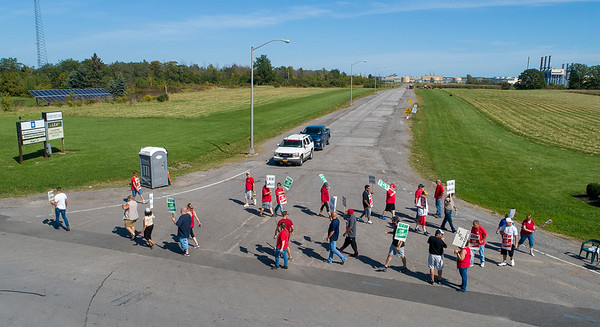 James Neiss/staff photographer <br /> Lockport, NY - Striking GM picketers walk the line at the Lockport Junction Road entrance in Lockport, very slowly letting those that crossed the line through.