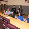 James Neiss/Staff Photographer<br /> Pendleton, NY - Heather Bugenhagen is all smiles after signing a letter of intent to compete in Division I Women's Cross Country/Track for the Canisius College Golden Griffins.  Heather was joined by coaches, Matt Prohaska and Patricia Gasser and family member, from left, Grandmother Judy Bugenhagen, her father Donald, mother Diana and grandfather Robert Klopfer.