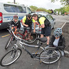 James Neiss/staff photographer <br /> Niagara Falls, NY - Niagara Falls Police Officer Tom Arist and Detective Pat Clifton jumped in to held Jean Hopkins, left, fix her bicycle as Elizabeth Flynn, right, checks out hers, before the annual NFPD Slow Roll. The riders left the City Market heading east on Pine, then North on Hyde Park, west on Pierce Ave, down to 11th where they headed south, up to Portage and turning east on Pine, back to the City Market real slow.