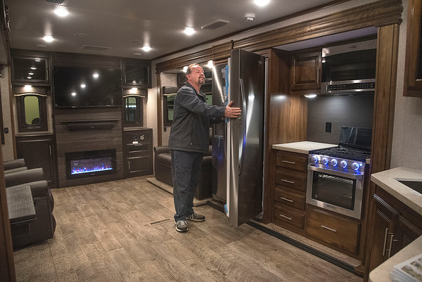 James Neiss/staff photographer <br /> Niagara Falls, NY - Rodney Michalak of Lewiston checks out the open concept kitchen/living room in this 38 foot Eagle trailer that's nicer than many homes, during the Niagara Falls RV Show at the Conference & Event Center Niagara Falls. The RV show runs through Sunday opening at 10am each day.
