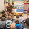 James Neiss/staff photographer <br /> Niagara Falls, NY - GJ Mann Elementary foster grandmother Constance Washington reads a story book to 1st graders that she fosters.