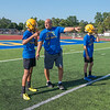 James Neiss/Staff Photographer<br /> Lockport, NY - Lockport High School football coach Trait Smith gives a few pointers to players during practice at Emmet Belknap Intermediate.