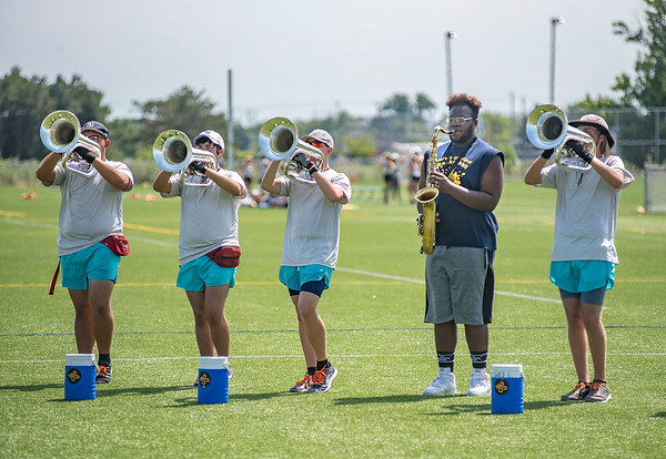 James Neiss/staff photographer <br /> Niagara Falls, NY - Tenor Sax player Dishawn Hudson, second from right,  joined other Niagara Falls Highschool band members to train with members of the Southwind Drum and Bugle Corp. for an afternoon clinic at the school on Wednesday.