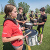James Neiss/staff photographer <br /> Niagara Falls, NY - Niagara Falls High School Students Karyn Goldman, left and Daniel Bryant, second from left, join members of the Southwind Drum and Bugle Corp. for snare practice with instructor Cole Smith, right. The Southwind Drum and Bugle Corp. held a clinic for Niagara Falls High School band members at the school on Wednesday.
