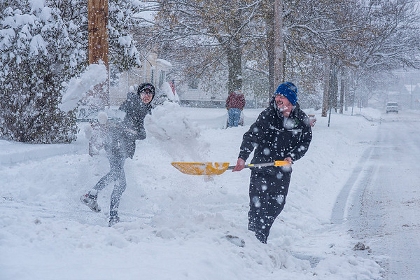 James Neiss/staff photographer <br /> Lockport, NY - It looked like Josh Barrett and step son Curtis Pareja were having a snow throwing competition clearing their Niagara Street driveway of snow. Whatever the motivation, they made quick work of it.