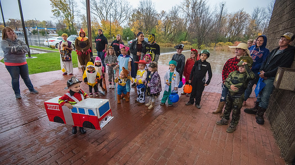 James Neiss/staff photographer <br /> Lockport, NY - Fireman Max Moyer, 3, came racing with lights flashing and siren blaring to the front of the line, as children and families waited for the doors to open to Trick or Treaters at the South Lockport Volunteer Fire hall. The hall opened their doors to trick or treaters because of the bad weather.