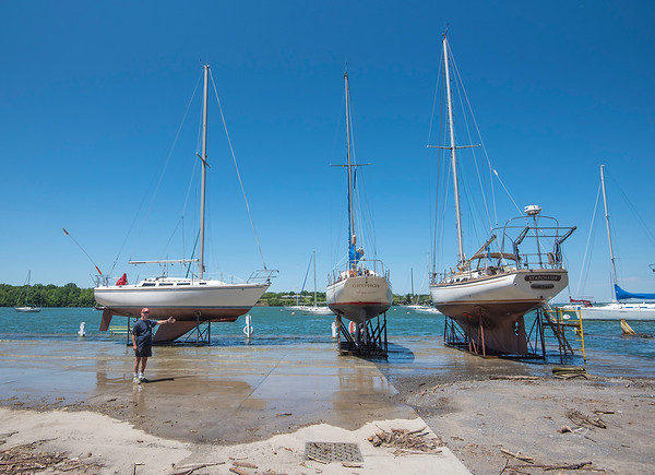 James Neiss/staff photographer <br /> Youngstwon, NY - High and dry is not the case at the RCR Yachts Marina along the Niagara River as yardman Andy Harold points out.