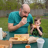 James Neiss/staff photographer <br /> Lockport, NY - Like father, like son. A family tradition may just be beginning as Lockport residence Matt Russell and his son Roland, 2, enjoy hamburgers at Reid's in Lockport.