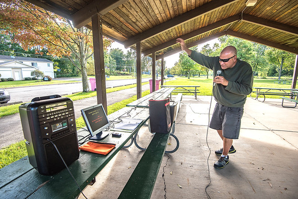 """James Neiss/staff photographer <br /> Lockport, NY - John """"KJ"""" Trusso, set up his karaoke machine in a shelter next to Widewaters Marina and belts out """"Sooner or Later"""" for all who care to listen as they walk by. Karaoke John, said he visits several parks in Niagara County, but lockport is his home base."""