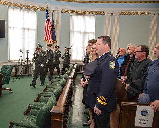 James Neiss/staff photographer <br /> Niagara Falls, NY - The Niagara Falls Police Honor Guard kicked off ceremonies at City Hall as Police Captain Thomas Licata stands with his wife Lisa and family members before being sworn in as the new Niagara Falls Police Superintendent.