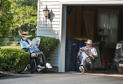 James Neiss/staff photographer  Lockport, NY - Kathleen and Glenn Hawerbier enjoy one of the last beautiful days of summer enjoying a good read in front of their Mcintosh Drive home. The first day of fall is Monday, September 23.