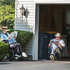 James Neiss/staff photographer <br /> Lockport, NY - Kathleen and Glenn Hawerbier enjoy one of the last beautiful days of summer enjoying a good read in front of their Mcintosh Drive home. The first day of fall is Monday, September 23.