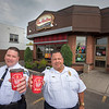 James Neiss/staff photographer <br /> Niagara Falls, NY - Niagara Falls Police Superintendent Thomas Licata and Niagara Falls Fire Chief Joseph Pedulla joined their personnel at Tim Hortons on Hyde Park Boulevard to help  raise money for Tim Hortons Camp Day.