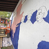 James Neiss/Staff Photographer<br /> Niagara Falls, NY - Niagara Falls artist Natalia Suska paints a mural of three freedom seekers who came through Niagara Falls on the underground railroad.