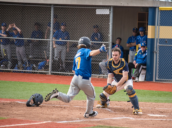 James Neiss/staff photographer <br /> Niagara Falls, NY -Niagara Falls catcher #3 Zachary Brydges tags out Lockport # 17 Fragale, during baseball game action in Niagara Falls.