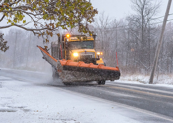 James Neiss/staff photographer <br /> Sanborn, NY - A snow plow salts Lower Mountain Road in Sanborn as the winter storm intensifies.
