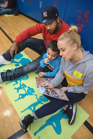 James Neiss/staff photographer <br /> Niagara Falls, NY - Parents Richard Young and Leah Fasciano took turns reading to their son Romeo Young, a pre-k student at Niagara Street Elementary, that hosted a Pre-K Parents Guest Reader's Day as a surprise for students.