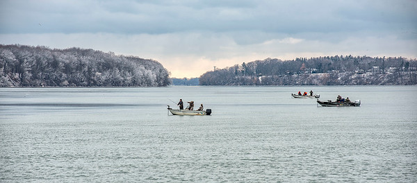 James Neiss/staff photographer <br /> Lewiston, NY - Fishermen apply their skills with hooks in the waters of the Niagara River off Lewiston Landing.
