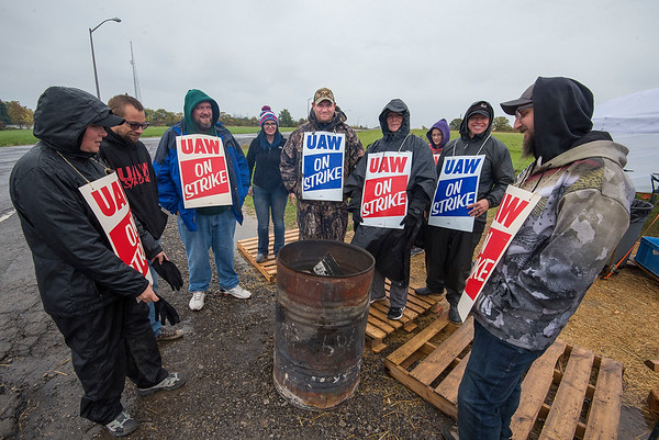 James Neiss/staff photographer <br /> Lockport, NY - Picketing seemed a bit less important than staying warm to striking UAW workers at the Lockport GM plant as word is out the two sides have cut a deal.