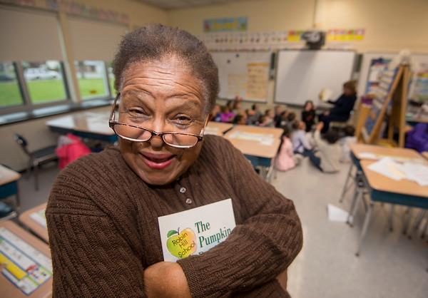 James Neiss/staff photographer <br /> Niagara Falls, NY - GJ Mann Elementary foster grandmother Constance Washington works volunteers in a 1st grade class.