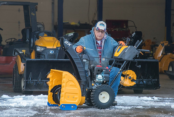 James Neiss/staff photographer <br /> Town of Niagara, NY - Delivery driver Bill Amacher checks the oil of a new snowblower in line for delivery at Niagara Lawn & Garden. Amacher said he had a trailer load of snowblowers for customers switching from mowing to snow throwing and a few newly bought, perhaps because of Monday's storm.