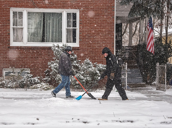 James Neiss/staff photographer <br /> North Tonawanda, NY - Father and Son Martin Vinda, right and Matthew, left, double team clearing the sidewalk in front of their Oliver Street home. The Vinda's said they wanted to get on it early and keep it clear all day.
